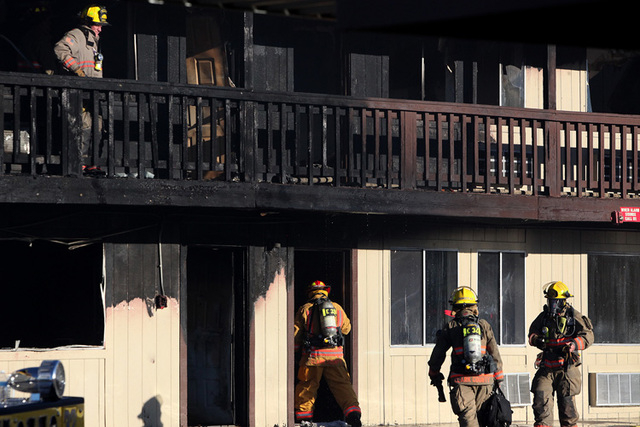 Clark County firefighters work a two-alarm fire at the American Inn on Harmon Avenue near the Las Vegas Strip on Wednesday, Sept. 24, 2014.(Justin Yurkanin/Las Vegas Review-Journal)