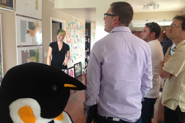 Bryan McArdle, who works for a nonprofit economic development organization in the Reno area, stands next to a stuffed penguin as he listens to guide Heidy Stamper discuss locations of Downtown Pro ...