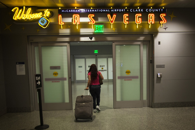 A woman leaves customs inside Terminal 3 at McCarran International Airport in this file photo. Over 5,800 visitors are expected to fly to Las Vegas this week for the El Grito weekend and Mexican I ...
