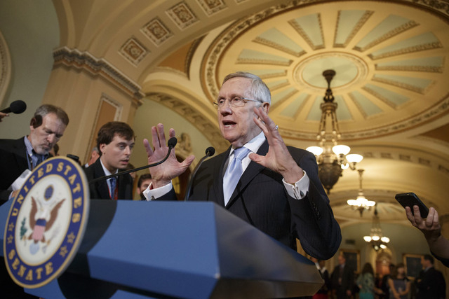 Senate Majority Leader Harry Reid, D-Nev., speaks with reporters following a Democratic policy lunch at the Capitol in Washington, Tuesday, Sept. 16, 2014. Reid is working to ensure that a nuclear ...