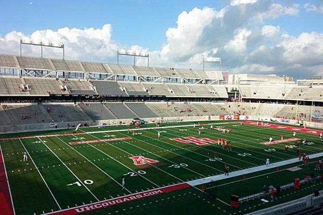 Players warm up on the field in Houston before Saturday's game between the Rebels and the Cougars. (Mark Anderson/Las Vegas Review-Journal)