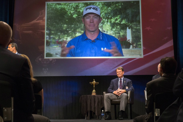 Ryder Cup team U.S. captain Tom Watson (C) listens as Hunter Mahan (on screen) speaks about being one of three picks to add to this year's Ryder Cup squad during an event in New York on Tuesday. U ...