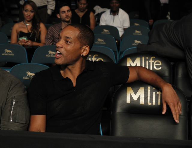 Actor Will Smith takes in the action before the Leo Santa Cruz verse Manuel Roman WBC super bantamweight title fight at the MGM Grand Garden Arena in Las Vegas on Saturday, Sept. 13, 2014. (Sam Mo ...