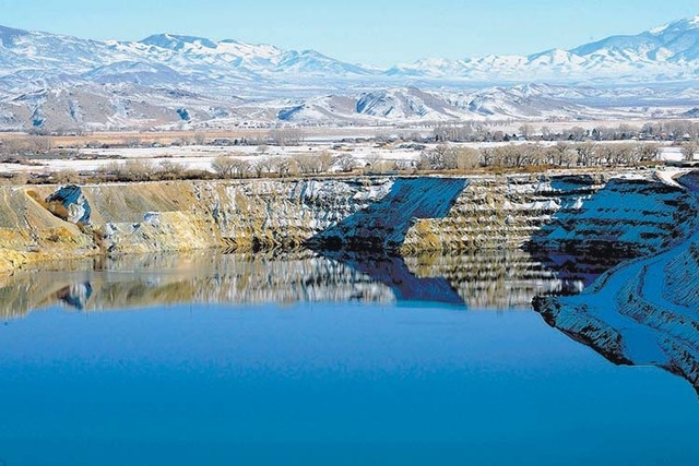 The old Anaconda mine pit is partially filled with water near Yerington, Nev. A bill being brought before the House of Representatives would allow the city of Yerington to develop federal land nea ...