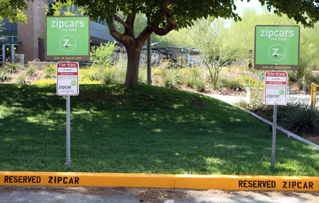 Zipcars live here signs are seen at UNLV campus, resident B lot, where Zipcar vehicles have reserved parking spot, on Thursday, Sept. 4, 2014, in Las Vegas. (Bizu Tesfaye/Las Vegas Review-Journal)