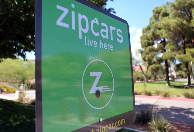 Zipcar sign is seen at Zipcar vehicles reserved parking spot at UNLV campus, resident B lot, on Thursday, Sept. 4, 2014, in Las Vegas. (Bizu Tesfaye/Las Vegas Review-Journal)