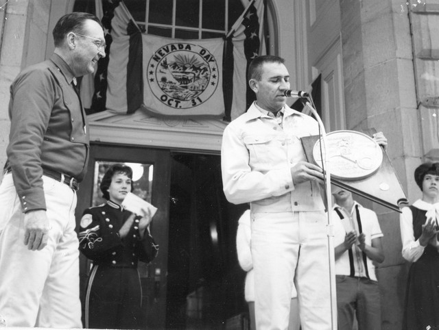 Governor Grant Sawyer with Centennial Medallion. (Courtesy Nevada State Library and Archives)