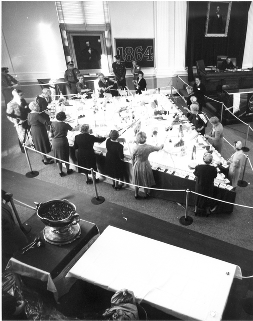 Volunteers prepare to cut a birthday cake made for Nevada's centennial in 1964. (Courtesy Nevada State Library and Archives)