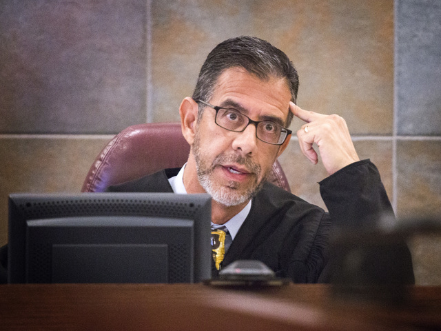 Judge Michael Villani  during a payment for witness's rent hearing in Regional Justice Center  on Tuesday, Oct. 28, 2014 Judge Villani denied defense attorney  Betsy Allen's motions to overturn th ...