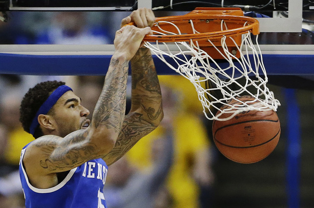 Kentucky forward Willie Cauley-Stein (15) dunks against Wichita State during the second half of a third-round game of the NCAA college basketball tournament Sunday, March 23, 2014, in St. Louis. ( ...