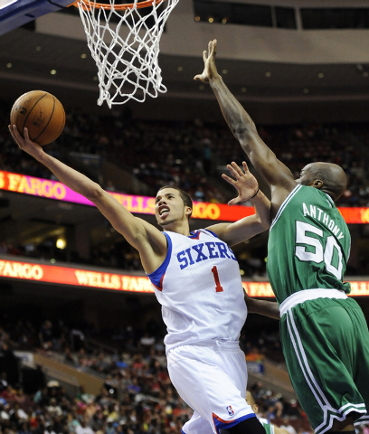 In this April 14, 2014 file photo, Philadelphia 76ers' Michael Carter-Williams (1) drives to the basket past Boston Celtics' Joel Anthony (50) during the second half of an NBA basketball game in P ...