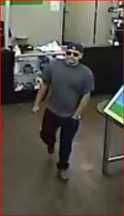 The man involved in a string of Las Vegas cellphone business robberies is being sought for four additional robberies, Las Vegas police said. (Courtesy/Las Vegas Metropolitan Police Department)