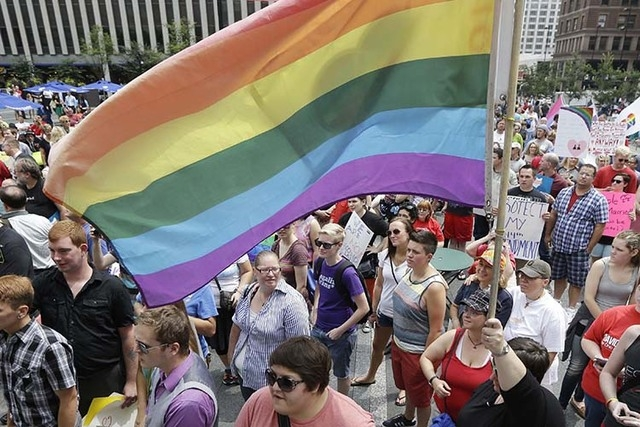 Gay marriage supporters rally on Fountain Square, Aug. 6, 2014, in Cincinnati. (AP File Photo)