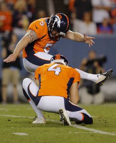 In this photo taken Saturday, Aug. 23, 2014, Denver Broncos kicker Matt Prater (5) boots the ball during the first half of an NFL preseason football game against the Houston Texans in Denver. The  ...