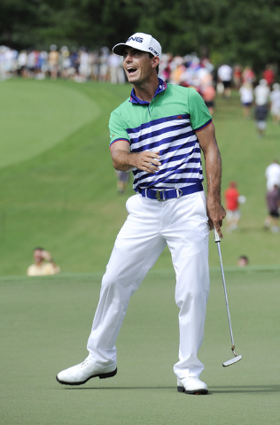 Bily Horschel reacts after just missing a putt for birdie  on the seventh hole during the third round of play in the Tour Championship golf tournament, Saturday, Sept. 13, 2014, in Atlanta. (AP Ph ...