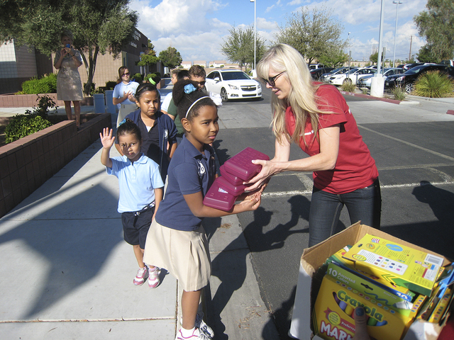 On Sept. 9, 2014, Bank of America volunteers loaded up a large truck and hand-delivered more than 12,000 supplies to students at Sandy Miller Elementary and Monaco Middle School. Bank employee A.J ...