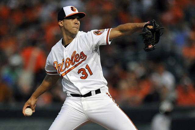 Sep 16, 2014; Baltimore, MD, USA; Baltimore Orioles starting pitcher Ubaldo Jimenez (31) pitches in the first inning against the Toronto Blue Jays at Oriole Park at Camden Yards. (Joy R. Absalon-U ...