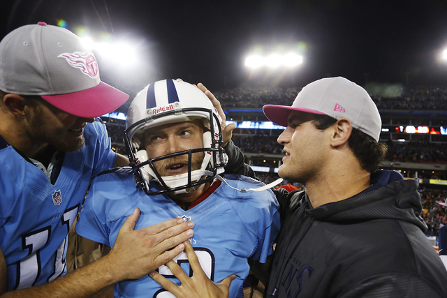 Tennessee Titans' kicker Rob Bironas (C) celebrates with Rusty Smith (L) after Bironas kicked a 40-yard field goal to lead the Titans to a win in the last seconds of their NFL football game agains ...