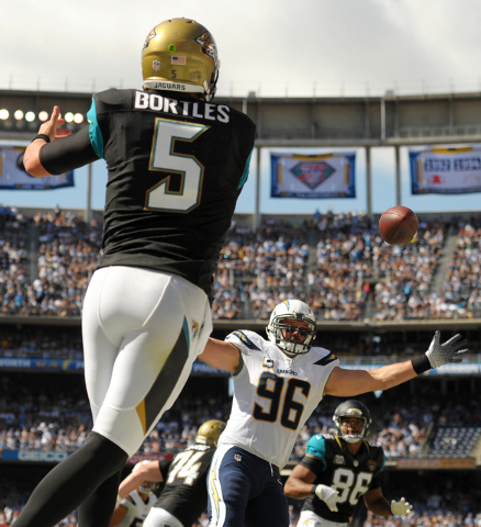 Jacksonville Jaguars quarterback Blake Bortles (5) throws the ball over San Diego Chargers outside linebacker Jarret Johnson (96) during the second quarter at Qualcomm Stadium on Sept. 28, 2014. ( ...