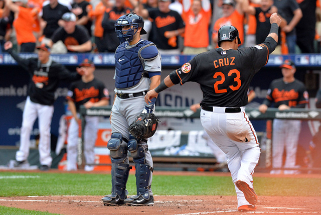 Oct 3, 2014; Baltimore, MD, USA; Baltimore Orioles designated hitter Nelson Cruz (23) scores against the Detroit Tigers during the eighth inning of game two of the 2014 ALDS playoff baseball game  ...