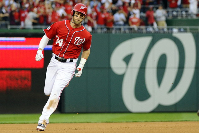 Oct 3, 2014; Washington, DC, USA; Washington Nationals left fielder Bryce Harper (34) rounds the bases after hitting a solo home run in the seventh inning against the San Francisco Giants in game  ...