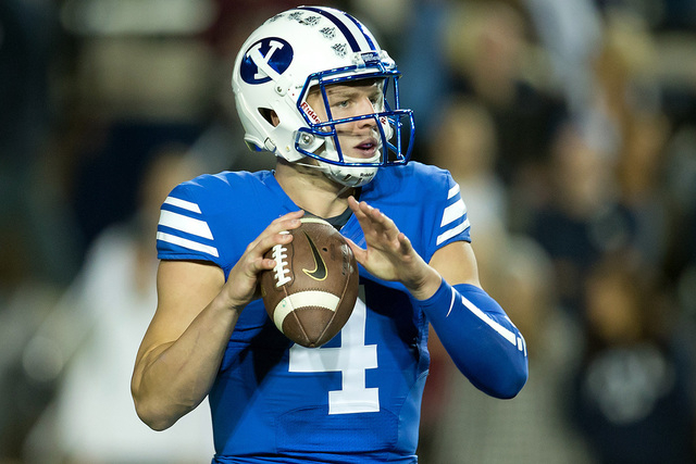 Oct 3, 2014; Provo, UT, USA; Brigham Young Cougars quarterback Taysom Hill (4) looks to pass during the first quarter against the Utah State Aggies at Lavell Edwards Stadium. (Russ Isabella-USA TO ...