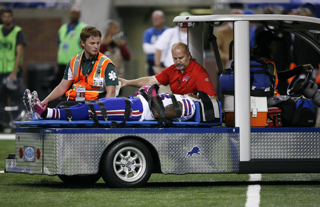 Oct 5, 2014; Detroit, MI, USA; Buffalo Bills cornerback Ron Brooks (33) taken off the field in a stretcher during the first quarter against the Detroit Lions at Ford Field. (Raj Mehta-USA TODAY Sp ...