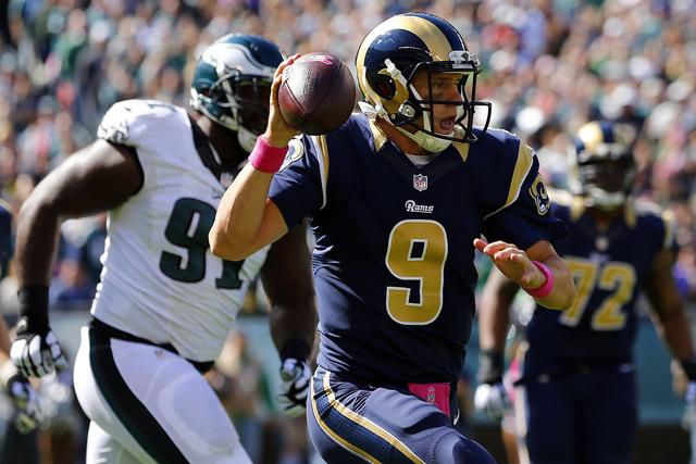 Oct 5, 2014; Philadelphia, PA, USA; St. Louis Rams quarterback Austin Davis (9) runs with the ball as Philadelphia Eagles defensive end Fletcher Cox (91) tries to defend during the first half at L ...