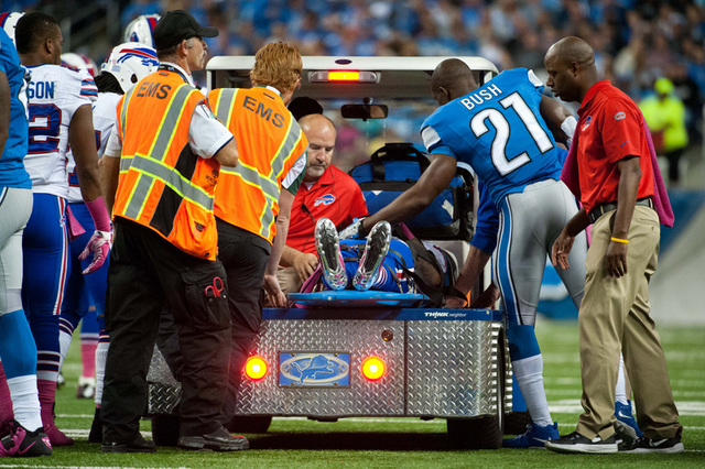 Oct 5, 2014; Detroit, MI, USA; Detroit Lions running back Reggie Bush (21) says goodbye to Buffalo Bills cornerback Ron Brooks (33) during the first quarter at Ford Field. (Tim Fuller-USA TODAY Sp ...