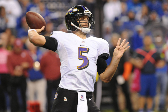 Oct 5, 2014; Indianapolis, IN, USA; Baltimore Ravens quarterback Joe Flacco (5) against the Indianapolis Colts in the second half at Lucas Oil Stadium. Colts won, 20-13. (Thomas J. Russo-USA TODAY ...