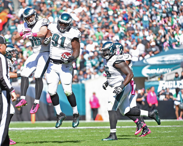 Oct 5, 2014; Philadelphia, PA, USA; Philadelphia Eagles defensive end Fletcher Cox (91) celebrates his fumble recovery with inside linebacker Casey Matthews (50) against the St. Louis Rams  at Lin ...