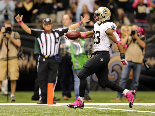 Oct 5, 2014; New Orleans, LA, USA; New Orleans Saints running back Pierre Thomas (23) scores on a 27-yard run in the third quarter of their game against the Tampa Bay Buccaneers at the Mercedes-Be ...