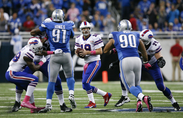 Oct 5, 2014; Detroit, MI, USA; Buffalo Bills quarterback Kyle Orton (18) drops back to pass the ball during the fourth quarter against the Detroit Lions at Ford Field. Bills beat the Lions 17-14.  ...