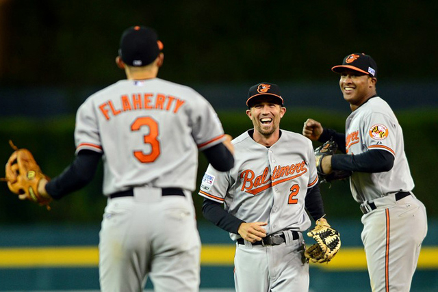 Baltimore Orioles shortstop J.J. Hardy (2), third baseman Ryan Flaherty (3) and second baseman Jonathan Schoop (6) celebrate after defeating the Detroit Tigers in game three of the 2014 ALDS baseb ...