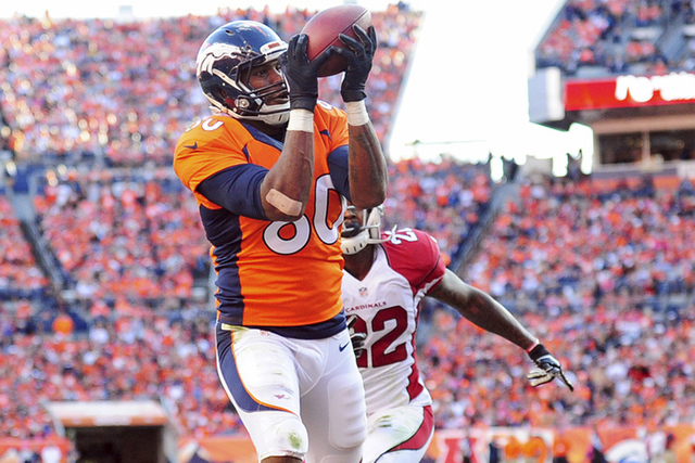 Oct 5, 2014; Denver, CO, USA Denver Broncos tight end Julius Thomas (80) pulls in a touchdown reception past Arizona Cardinals strong safety Tony Jefferson (22) in the fourth quarter at Sports Aut ...