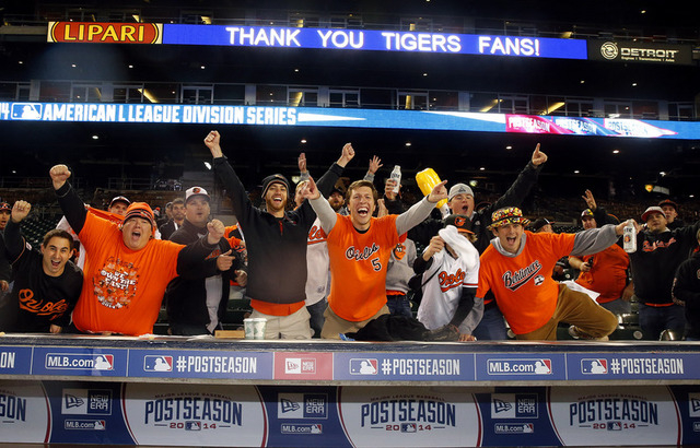 Baltimore Orioles fans celebrate after the Orioles defeated the Detroit Tigers in game three of the 2014 ALDS baseball playoff game at Comerica Park in Detroit, Sunday, Oct. 5, 2014. The Orioles m ...