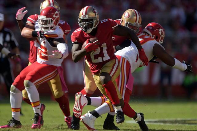 Oct 5, 2014; Santa Clara, CA, USA; San Francisco 49ers running back Frank Gore (21) against the Kansas City Chiefs at Levi's Stadium. The 49ers defeated the Chiefs 22-17.(Kirby Lee-USA TODAY Sports)
