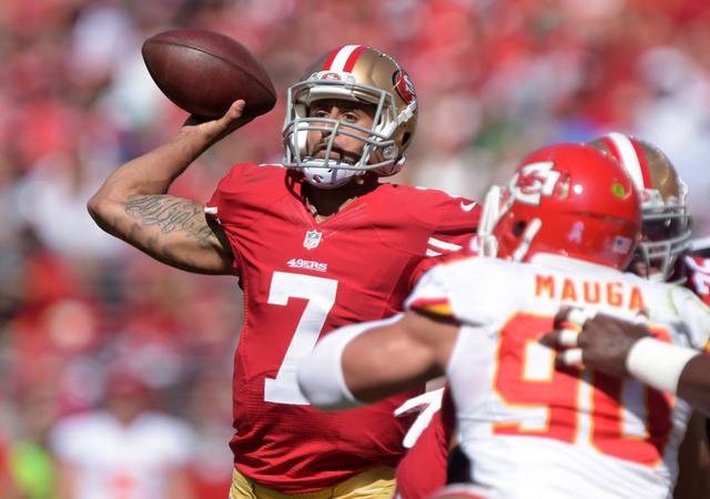 Oct 5, 2014; Santa Clara, CA, USA; San Francisco 49ers quarterback Colin Kaepernick (7) throws a pass against the Kansas City Chiefs at Levi's Stadium. (Kirby Lee-USA TODAY Sports)