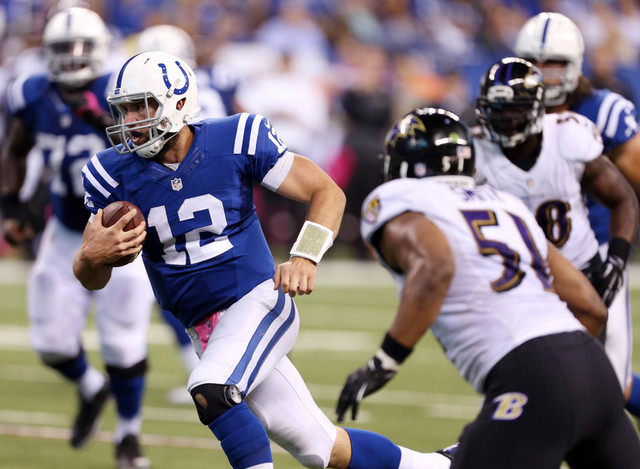 Oct 5, 2014; Indianapolis, IN, USA; Indianapolis Colts quarterback Andrew Luck (12) runs the ball in for a touchdown against the Baltimore Ravens at Lucas Oil Stadium. (Brian Spurlock-USA TODAY Sp ...