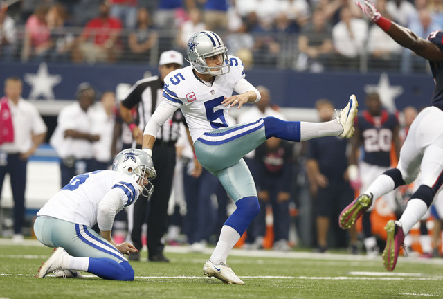 Oct 5, 2014; Arlington, TX, USA; Dallas Cowboys kicker Dan Bailey (5) kicks the game winning field goal in overtime against the Houston Texans at AT&T Stadium. The Cowboys beat the Texans 20-17 in ...