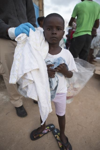 A young patient is discharged from the Island Clinic in Monrovia, September 30, 2014, where patients are treated for Ebola. After being refurbished by the Liberian Ministry of Health and Social We ...