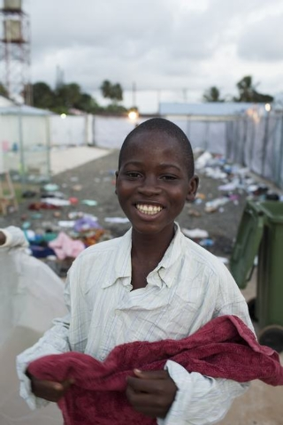 A young patient smiles as he is discharged from the Island Clinic in Monrovia, September 30, 2014, where patients are treated for Ebola. After being refurbished by the Liberian Ministry of Health  ...