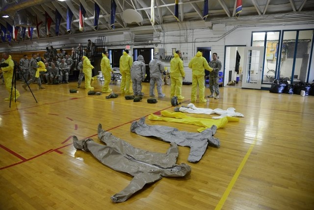 U.S. Army soldiers from the 101st Airborne Division (Air Assault), who are earmarked for the fight against Ebola, learn how to wear the protective suits before their deployment to West Africa, at  ...