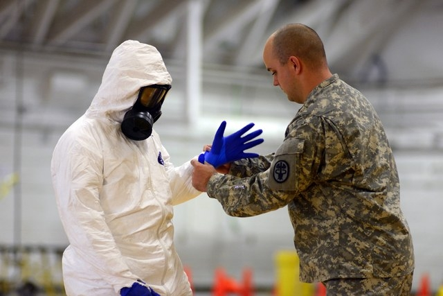 James Knight of U.S. Army Medical Research Institute of Infectious Diseases trains U.S. Army soldiers from the 101st Airborne Division (Air Assault), who are earmarked for the fight against Ebola, ...