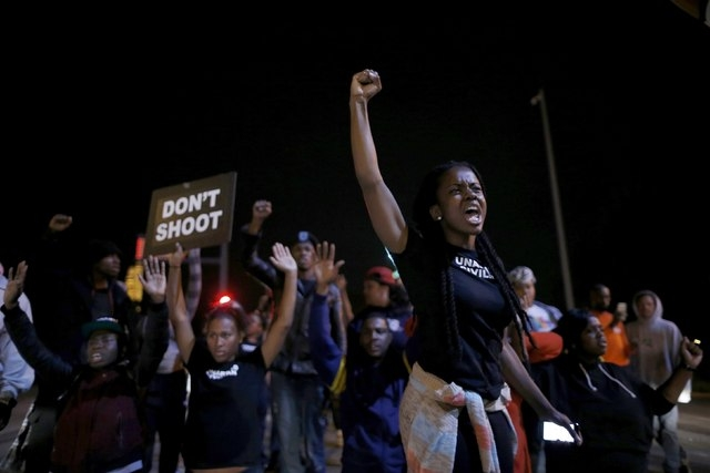 Protesters cheer after blocking an intersection after a vigil in St. Louis, Missouri, Thursday, Oct. 9, 2014.  (Reuters/Jim Young)