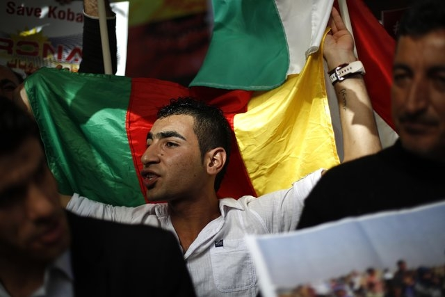 Kurdish men living in Bulgaria shout slogans during a protest in solidarity with the Syrian Kurds in front of the European Parliament and European Commission offices in Sofia October 10, 2014. (RE ...