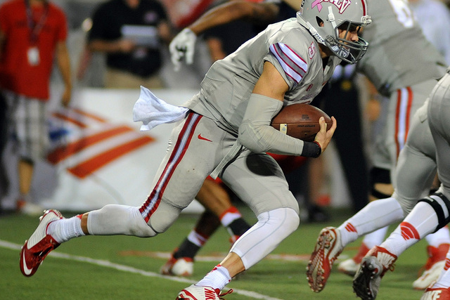 UNLV quarterback Blake Decker (5) carries the ball against Fresno State at Sam Boyd Stadium on Oct. 10, 2014. The Rebels won the game in overtime, 30-27.  (Stephen R. Sylvanie-USA TODAY Sports)