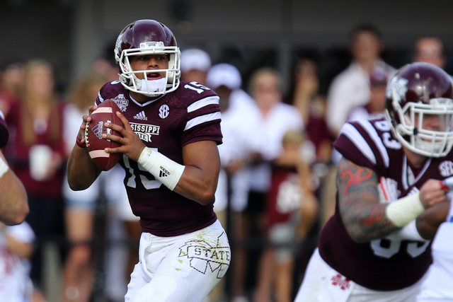 Oct 11, 2014; Starkville, MS, USA; Mississippi State Bulldogs quarterback Dak Prescott (15) drops back to pass the ball during the game against the Auburn Tigers at Davis Wade Stadium. (Spruce Der ...