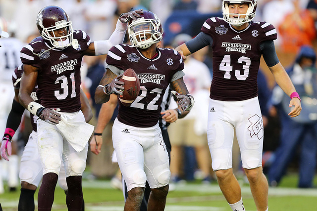 Oct 11, 2014; Starkville, MS, USA; Mississippi State Bulldogs linebacker Matthew Wells (22) celebrates after recovering a fumble during the game against the Auburn Tigers at Davis Wade Stadium. Mi ...