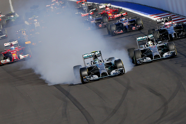Mercedes Formula One driver Nico Rosberg of Germany leads next to Mercedes Formula One driver Lewis Hamilton of Britain (R)  after the start of the first Russian Grand Prix in Sochi Oct. 12, 2014. ...